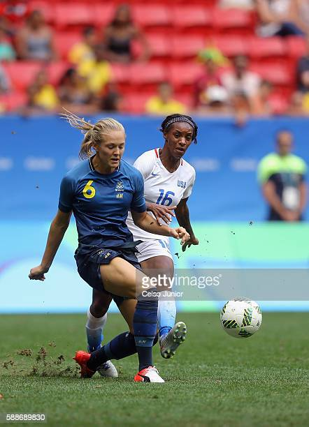 Magdalena Eriksson of Sweden battles for the ball against Crystal Dunn of United States in the second half during the Women's Football Quarterfinal...