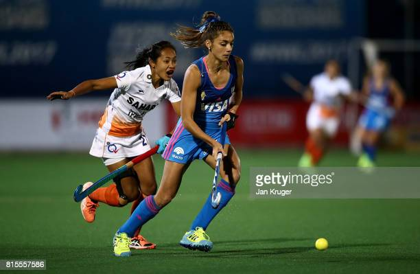 Magdalena Fernandez of Argentina controls the ball from Sushila Pukhrambam of India during day 5 of the FIH Hockey World League Women's Semi Finals...
