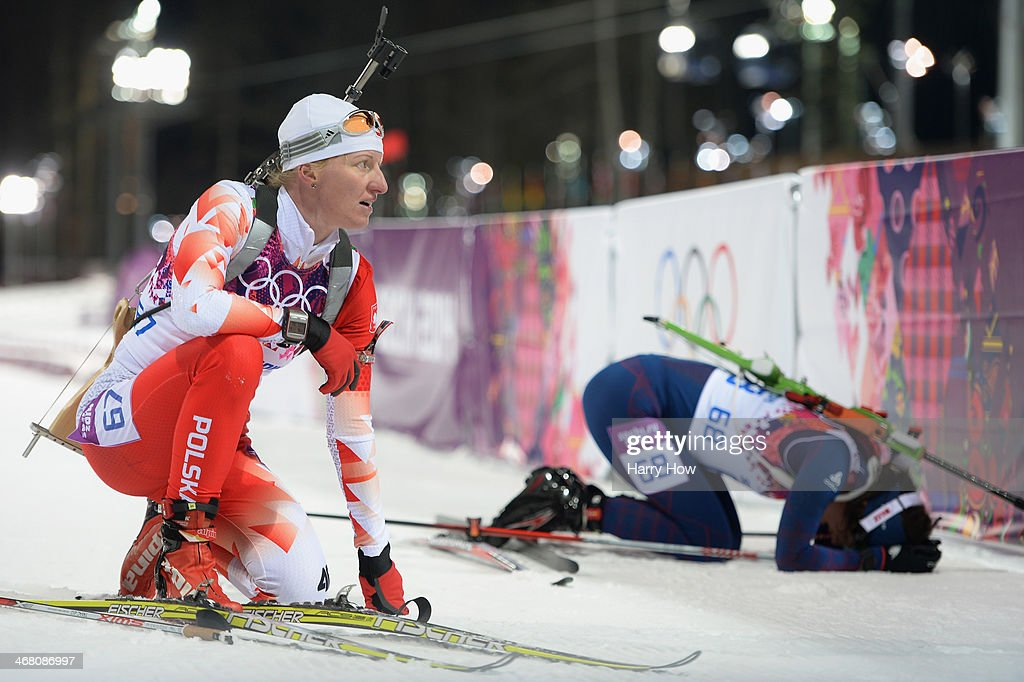 Magdalena Gwizdon (L) of Poland and Ann Kristin Aafedt Flatland of Norway collapse at the finish line in the Women's 7.5 km Sprint during day two of the Sochi 2014 Winter Olympics at Laura Cross-country Ski & Biathlon Center on February 9, 2014 in Sochi, Russia.