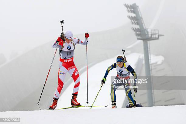 Magdalena Gwizdon of Poland and AnnaKarin Stroemstedt of Sweden compete during the IBU Biathlon World Cup Women's 10 km pursuit race on March 22 2014...