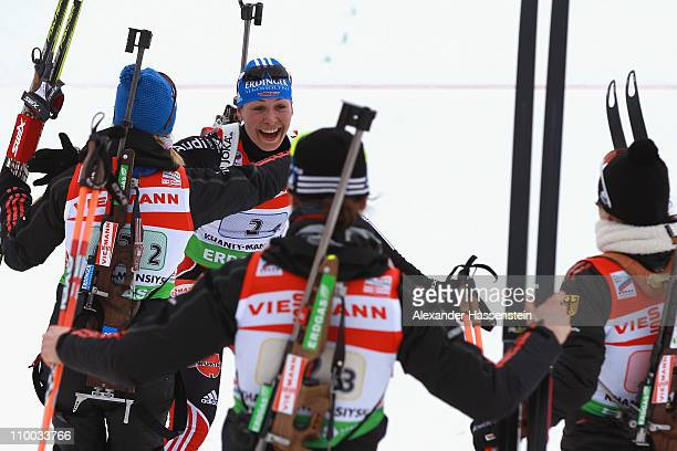 H 13 Magdalena Neuner 2nd l of Germany celebrates winning the gold medal with her team mates Andera Henkel Miriam Goessner and Tina Bachmann at the...