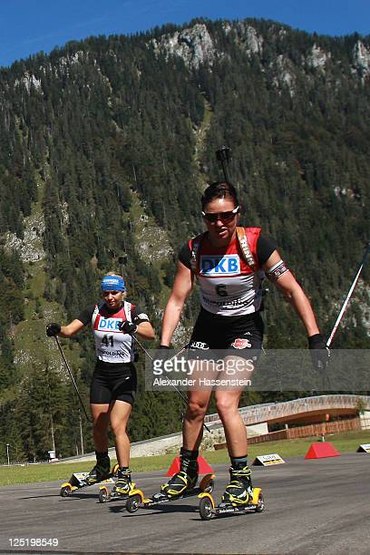 Magdalena Neuner of Germany and team mate Andrea Henkel compete in the women's 15 km individual event during the German Championships at the Chiemgau...