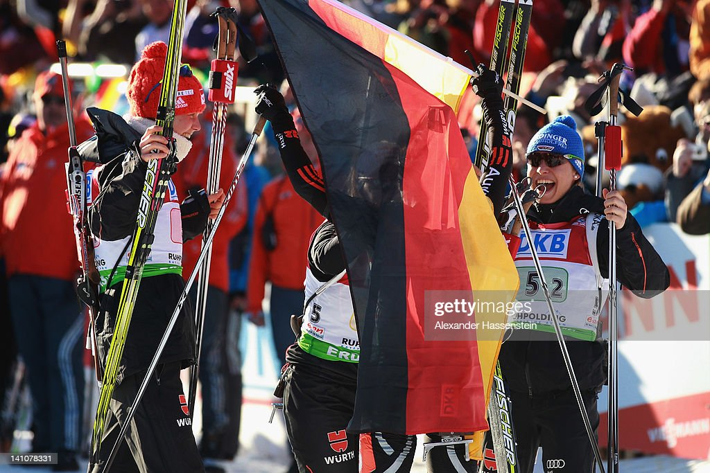<a gi-track='captionPersonalityLinkClicked' href=/galleries/search?phrase=Magdalena+Neuner&family=editorial&specificpeople=2095093 ng-click='$event.stopPropagation()'>Magdalena Neuner</a> (R) of Germany celebrates winning at the finsih area of the Women's 4 x 6km Relay with her team mates <a gi-track='captionPersonalityLinkClicked' href=/galleries/search?phrase=Andrea+Henkel&family=editorial&specificpeople=233764 ng-click='$event.stopPropagation()'>Andrea Henkel</a> (2nd R), Miriam Goessner (2nd L) and <a gi-track='captionPersonalityLinkClicked' href=/galleries/search?phrase=Tina+Bachmann&family=editorial&specificpeople=2132293 ng-click='$event.stopPropagation()'>Tina Bachmann</a> (L) during the IBU Biathlon World Championships at Chiemgau Arena on March 10, 2012 in Ruhpolding, Germany.
