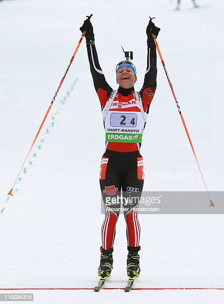 Magdalena Neuner of Germany celebrates winning the gold medal at the finish line of the women's relay during the IBU Biathlon World Championships at...