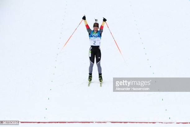 Magdalena Neuner of Germany celebrates winning the gold medal in the Women's Biathlon 10km Pursuit on day 5 of the 2010 Vancouver Winter Olympics at...