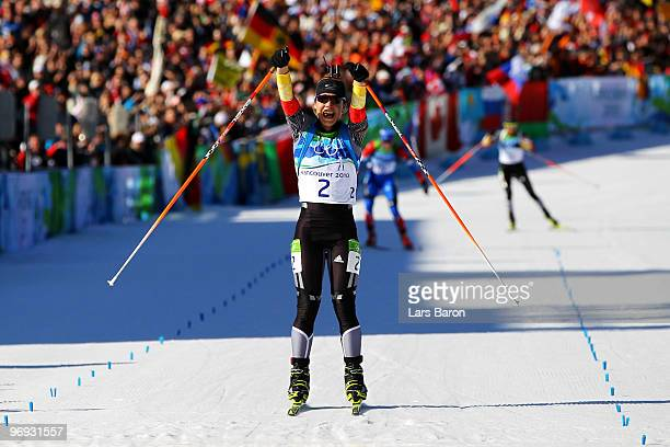 Magdalena Neuner of Germany crosses the line to win gold in the women's biathlon 125 km mass start on day 10 of the 2010 Vancouver Winter Olympics at...