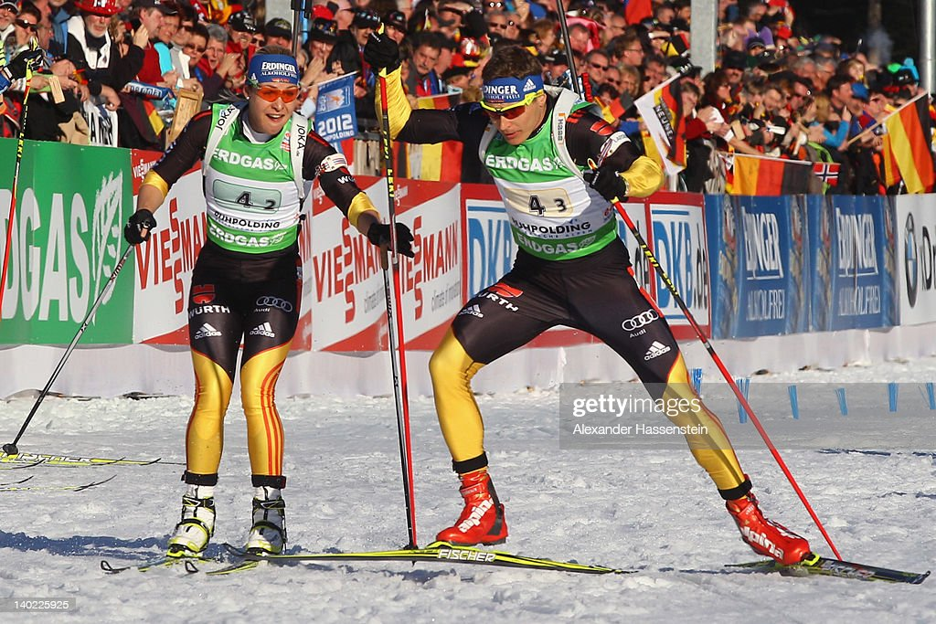 Magdalena Neuner of Germany hand so her to her team mate Andreas Birnbacher during the IBU Biathlon World Championships Mixed Relay on March 1 2012...