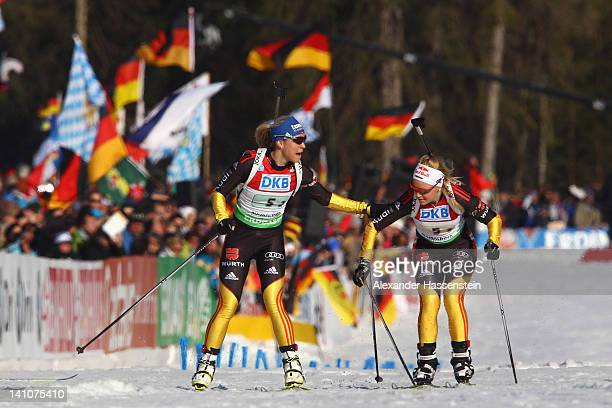 Magdalena Neuner of Germany hands over to her team mate Miriam Goessner during the Women's 4 x 6km Relay during the IBU Biathlon World Championships...