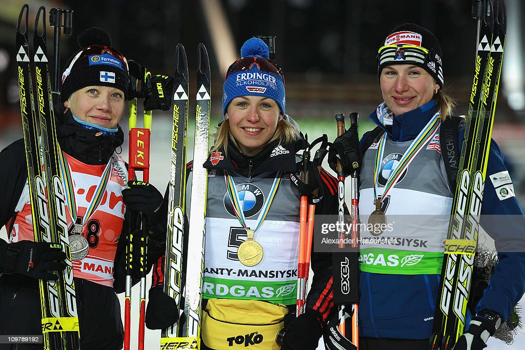 <a gi-track='captionPersonalityLinkClicked' href=/galleries/search?phrase=Magdalena+Neuner&family=editorial&specificpeople=2095093 ng-click='$event.stopPropagation()'>Magdalena Neuner</a> (C, gold medal) of Germany, Kaisa Maekaeraeinen (L, silver medal) and <a gi-track='captionPersonalityLinkClicked' href=/galleries/search?phrase=Anastasiya+Kuzmina&family=editorial&specificpeople=6738529 ng-click='$event.stopPropagation()'>Anastasiya Kuzmina</a> (R, bronze medal) of Slovakia pose at the victory ceremony after the women's 7,5km sprint during the IBU Biathlon World Championships at A.V. Philipenko winter sports centre on March 5, 2011 in Khanty-Mansiysk, Russia.