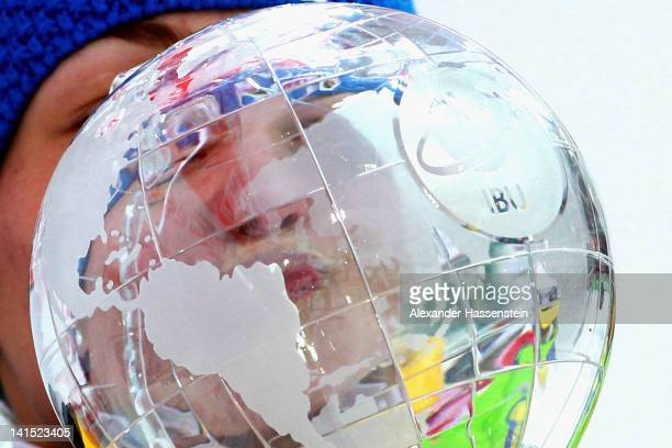 Magdalena Neuner of Germany kisses her World Cup winner trophy after the Women's 125km Mass Start event of the IBU Biathlon World Cup at AV...