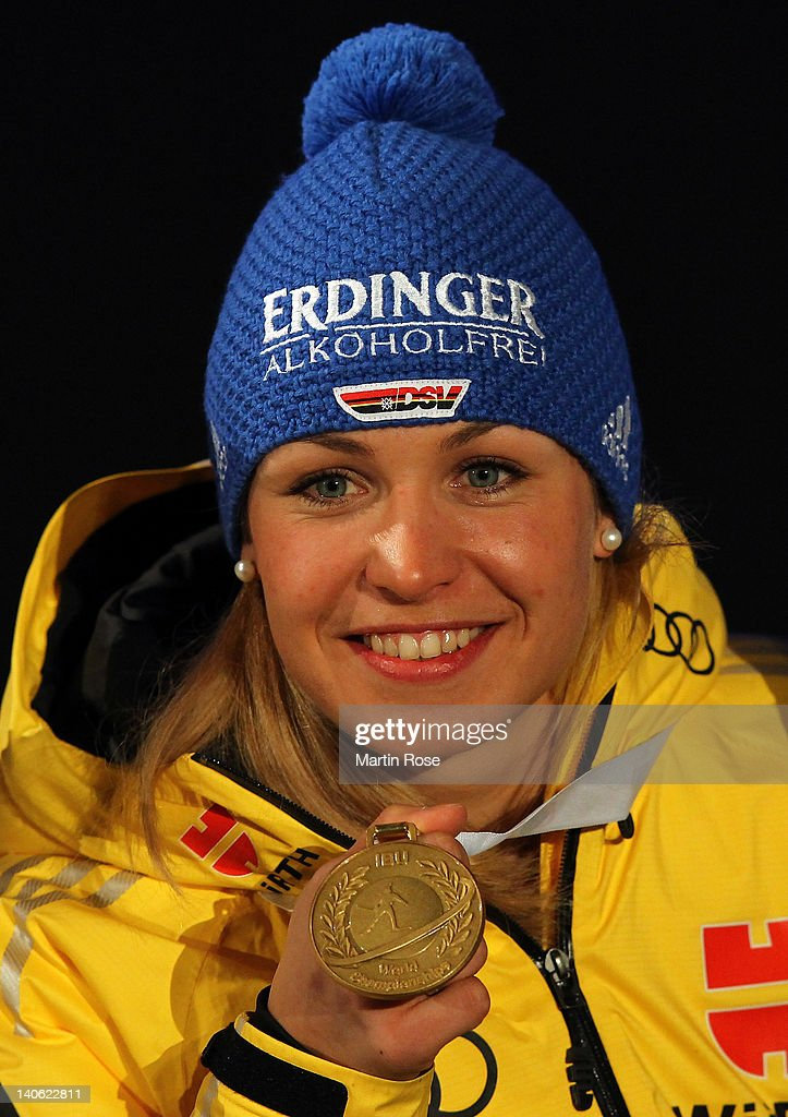 <a gi-track='captionPersonalityLinkClicked' href=/galleries/search?phrase=Magdalena+Neuner&family=editorial&specificpeople=2095093 ng-click='$event.stopPropagation()'>Magdalena Neuner</a> of Germany poses with her gold medal at the medal ceremony for the IBU Biathlon World Championships Women's 7,5km Sprint on March 3, 2012 in Ruhpolding, Germany.