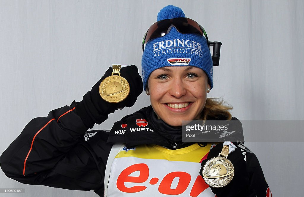 <a gi-track='captionPersonalityLinkClicked' href=/galleries/search?phrase=Magdalena+Neuner&family=editorial&specificpeople=2095093 ng-click='$event.stopPropagation()'>Magdalena Neuner</a> of Germany poses with her gold medal for the women's 7,5km sprint and bronze medal for the mixed relay during the IBU Biathlon World Championships at Chiemgau Arena on March 3, 2012 in Ruhpolding, Germany.