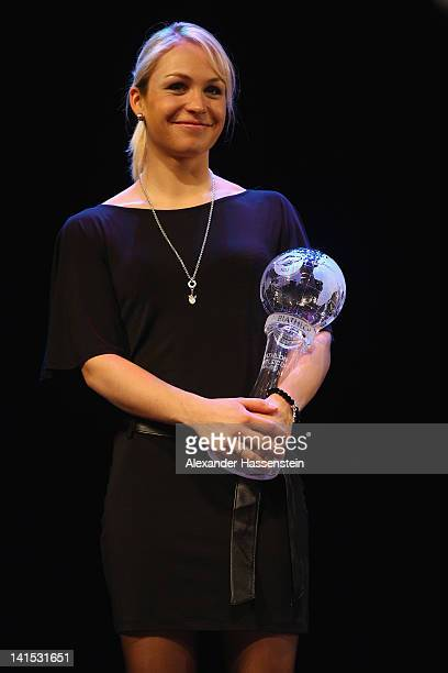 Magdalena Neuner of Germany poses with her World Cup winner trophy during the IBU Awarding Ceremony at Ugra Classic concert hall on March 18 2012 in...