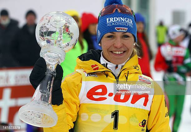Magdalena Neuner of Germany poses with the World Cup winner trophy after the Women's 125km Mass Start event of the IBU Biathlon World Cup at AV...
