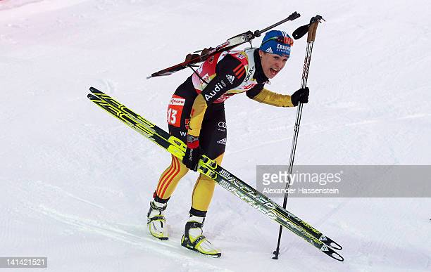 Magdalena Neuner of Germany reacts at the finish area after the Women's 75km Sprint event of the IBU Biathlon World Cup at AV Philipenko winter...