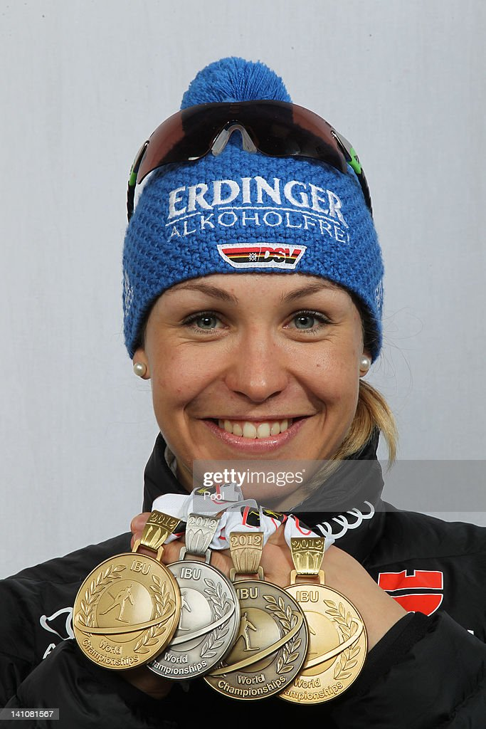 <a gi-track='captionPersonalityLinkClicked' href=/galleries/search?phrase=Magdalena+Neuner&family=editorial&specificpeople=2095093 ng-click='$event.stopPropagation()'>Magdalena Neuner</a> of Germany shows her medals of the Women's 4 x 6km Relay during the IBU Biathlon World Championships at Chiemgau Arena on March 10, 2012 in Ruhpolding, Germany.