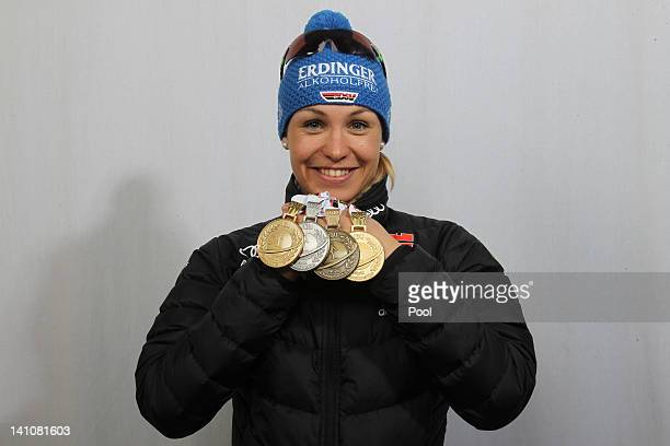 Magdalena Neuner of Germany shows her medals of the Women's 4 x 6km Relay during the IBU Biathlon World Championships at Chiemgau Arena on March 10...