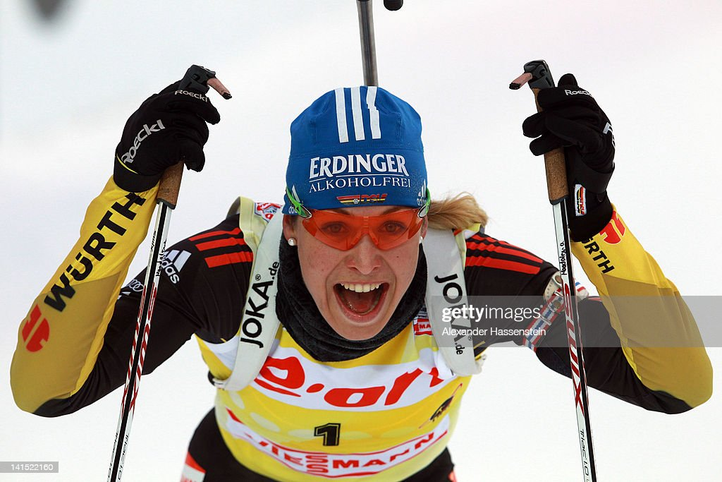 <a gi-track='captionPersonalityLinkClicked' href=/galleries/search?phrase=Magdalena+Neuner&family=editorial&specificpeople=2095093 ng-click='$event.stopPropagation()'>Magdalena Neuner</a> of Germany smiles after crossing the finish line after the Women's 12.5km Mass Start event of the IBU Biathlon World Cup at A.V. Philipenko winter sports centre on March 18, 2012 in Khanty-Mansiysk, Russia. <a gi-track='captionPersonalityLinkClicked' href=/galleries/search?phrase=Magdalena+Neuner&family=editorial&specificpeople=2095093 ng-click='$event.stopPropagation()'>Magdalena Neuner</a> is competing in the final race of her career today. Neuner has won this year's World Cup and is a two time Olympic Champion with twelve World Champion titles to her name.