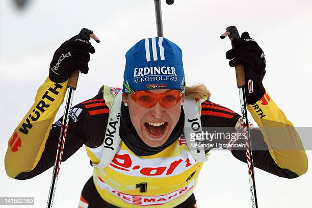 Magdalena Neuner of Germany smiles after crossing the finish line after the Women's 125km Mass Start event of the IBU Biathlon World Cup at AV...