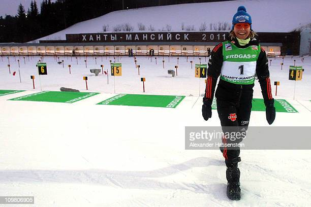 Magdalena Neuner of Germany smiles after falling from a reindeer sleigh as she celebrates her victory after winning the silver medal in the women's...