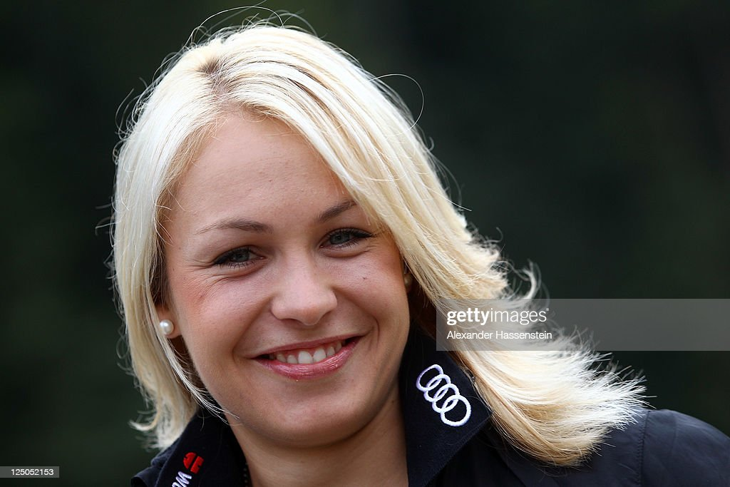 <a gi-track='captionPersonalityLinkClicked' href=/galleries/search?phrase=Magdalena+Neuner&family=editorial&specificpeople=2095093 ng-click='$event.stopPropagation()'>Magdalena Neuner</a> of team Germany smiles during the Biathlon mediaday at Chiemgau Arena in Ruhpolding on September 15, 2011 in Ruhpolding, Germany.