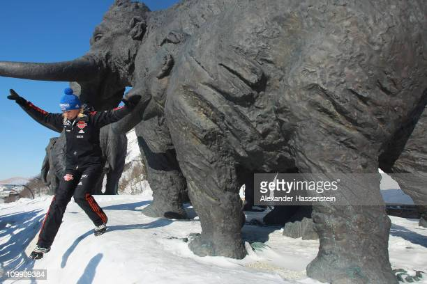 Magdalena Neuner poses in front of mammoth figures during a photocall of the German Biathlon Woman Team at the Archeopark on March 10 2011 in...
