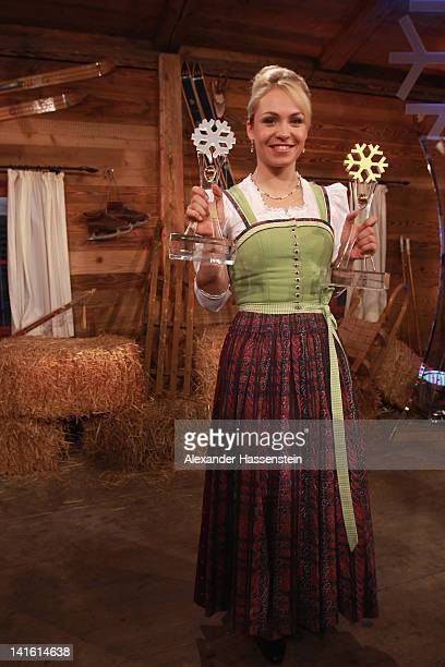 Magdalena Neuner poses with her WinterStar 2012 awrads after the WinterStar 2012 awarding ceremony on March 19 2012 in Erding Germany