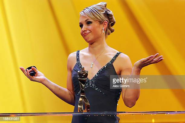 Magdalena Neuner reacts after being awarded female 'Athlete of the Year 2012' during a gala at the Kurhaus BadenBaden on December 16 2012 in...