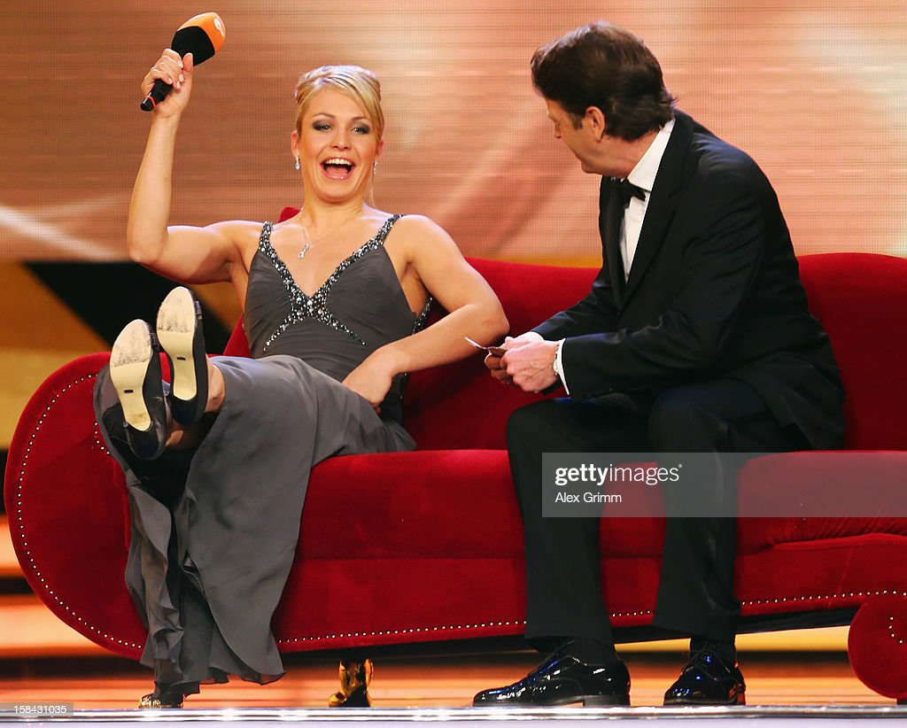 <a gi-track='captionPersonalityLinkClicked' href=/galleries/search?phrase=Magdalena+Neuner&family=editorial&specificpeople=2095093 ng-click='$event.stopPropagation()'>Magdalena Neuner</a> sits on the sofa with host Rudi Cerne after being awarded female 'Athlete of the Year 2012' during a gala at the Kurhaus Baden-Baden on December 16, 2012 in Baden-Baden, Germany.