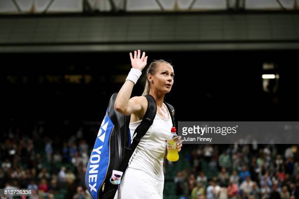 Magdalena Rybarikova of Slovakia acknowledges the crowd as she celebrates victory after the Ladies Singles quarter final match against Coco...