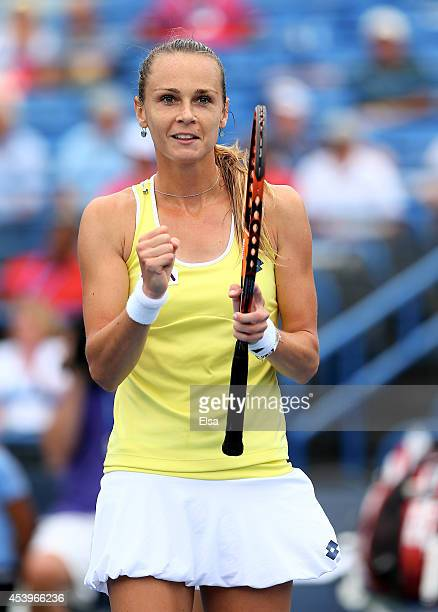 Magdalena Rybarikova of Slovakia celebrates her match win over Camila Giorgi of Italy during the Connecticut Open at the Connecticut Tennis Center at...