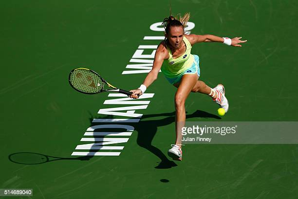 Magdalena Rybarikova of Slovakia plays a forehand in her match against Laura Robson of Great Britain during day four of the BNP Paribas Open at...
