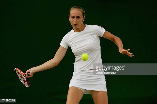 Magdalena Rybarikova of Slovakia returns a forehand to Tamira Paszek of Austria during the Girls' singles Semifinal on day eleven of the Wimbledon...