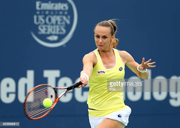 Magdalena Rybarikova of Slovakia returns a shot to Camila Giorgi of Italy during the Connecticut Open at the Connecticut Tennis Center at Yale on...