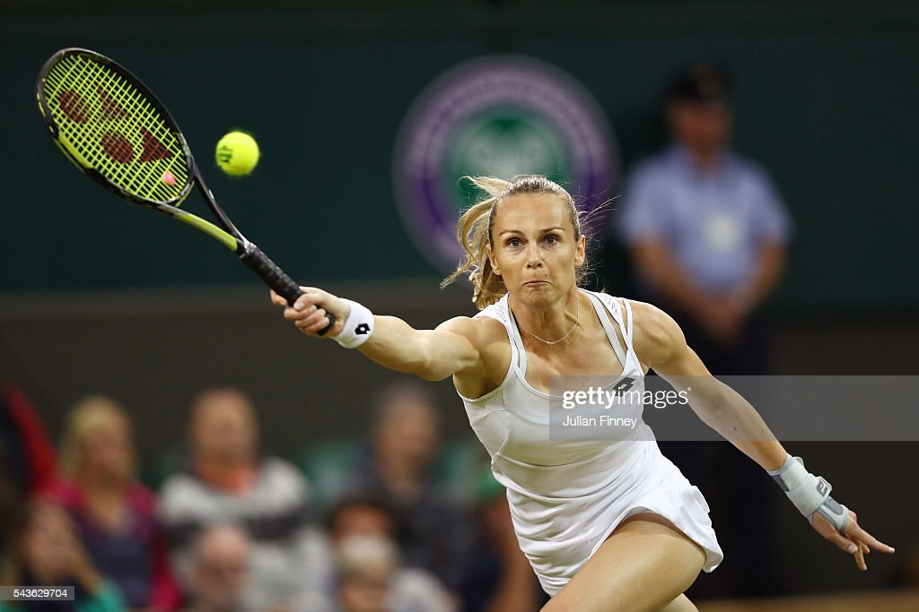 <a gi-track='captionPersonalityLinkClicked' href=/galleries/search?phrase=Magdalena+Rybarikova&family=editorial&specificpeople=5407479 ng-click='$event.stopPropagation()'>Magdalena Rybarikova</a> of Slovakia volleys during the Ladies Singles first round match against Eugenie Bouchard of Canada on day three of the Wimbledon Lawn Tennis Championships at the All England Lawn Tennis and Croquet Club on June 29, 2016 in London, England.