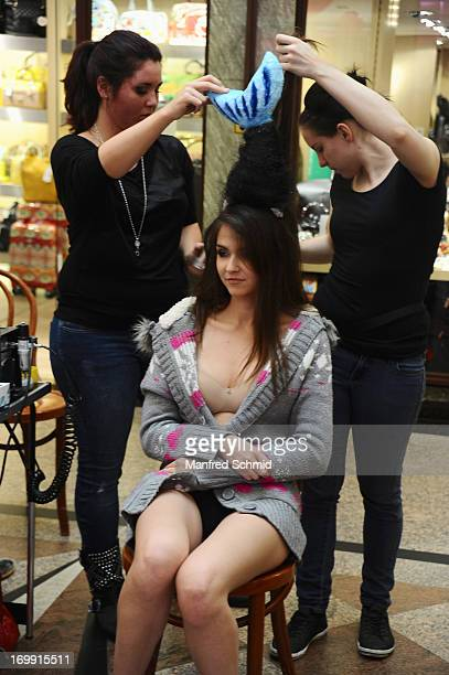 Magdalena Thanner poses for a photograph at 4elementsshoot with Miss Earth in Wiener Ringstrassen Gallerien on June 4 2013 in Vienna Austria
