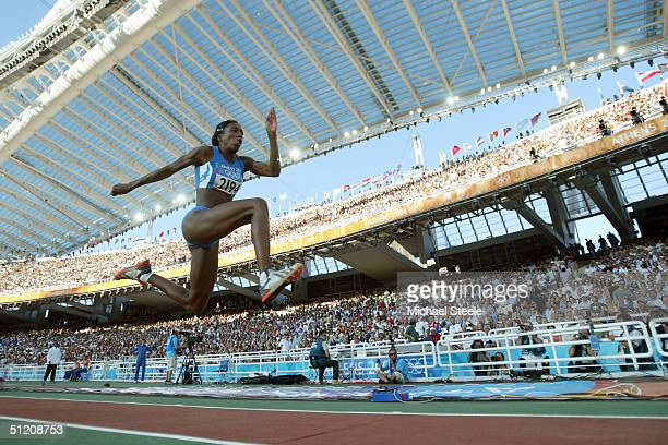 Magdelin Martinez of Italy competes in the women's triple jump final on August 23 2004 during the Athens 2004 Summer Olympic Games at the Olympic...