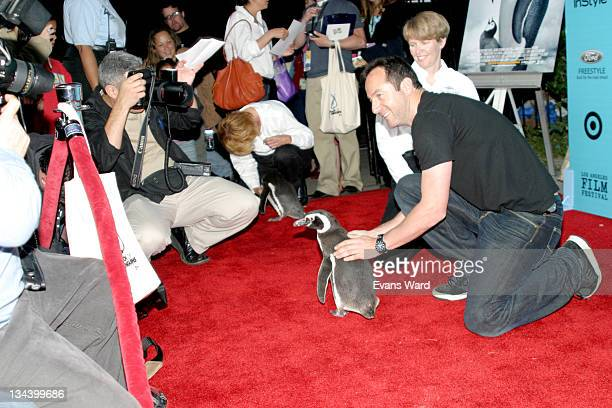 A Magellanic Penguin from Sea World and Jason Isaacs meet the press