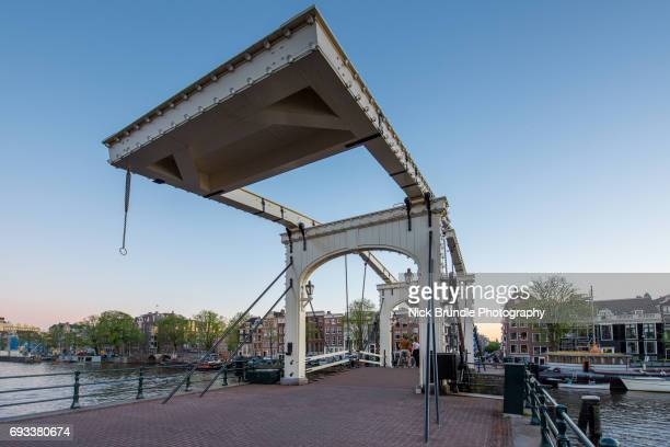 Magere Brug (Skinny Bridge), on the Amstel River at dusk, Amsterdam, North Holland, Netherlands, Europe