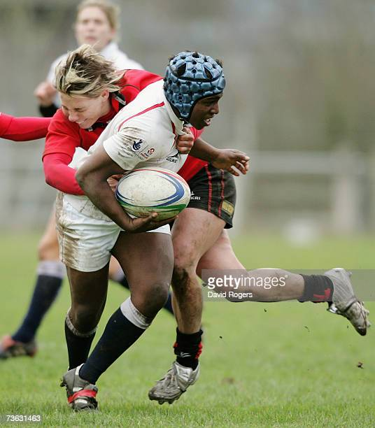 Maggie Alphonsi of England is tackled by Jamie Kift of Wales during the Women's Rugby Union International match between Wales and England at Taffs...