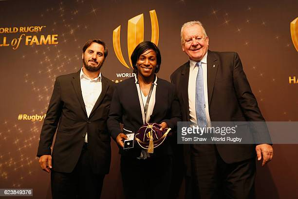 Maggie Alphonsi of England receives her induction to the Hall of Fame from Agustin Pichot of Argentina and Bill Beaumont the Chief Executive of World...
