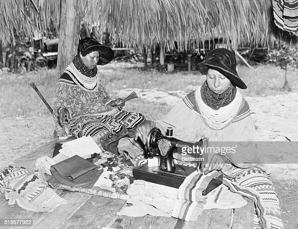 Maggie Billy fashions a corn husk doll while her sister Lilly Billy makes clothing on a Singer sewing machine for an upcoming festival in Miami...