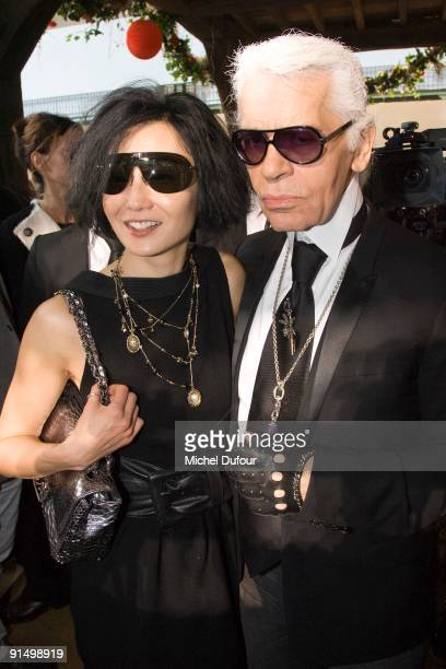 Maggie Cheung and Karl Lagerfeld attend the Chanel Pret a Porter show as part of Paris Womenswear Fashion Week Spring/Summer 2010 at Grand Palais on...