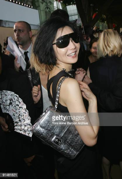 Maggie Cheung attends the Chanel Pret a Porter show as part of the Paris Womenswear Fashion Week Spring/Summer 2010 at the Grand Palais on October 6...