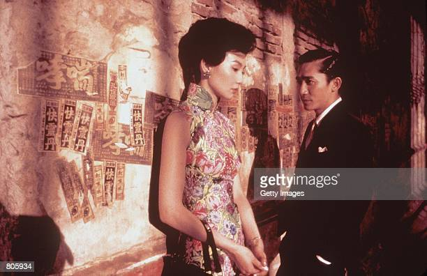Maggie Cheung left stars as Lizhen and Tony Leung stars as Chow in the Wong KarWai film 'In The Mood For Love' a USA Films release To be released on...