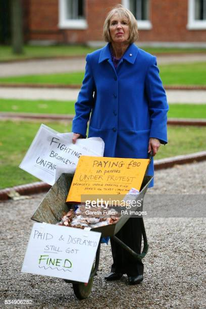 Maggie Gebbett arrives at Bromley Civic Centre in Bromley Kent to pay a parking fine of 80 with a wheelbarrow full of copper coins