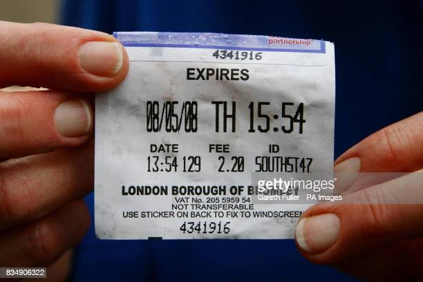 Maggie Gebbett holds her original parking ticket as she arrives at Bromley Civic Centre in Bromley Kent to pay a parking fine of 80 with a...