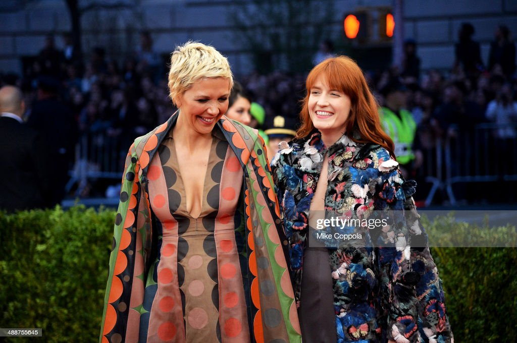 Maggie Gyllenhaal (L) and Florence Welch attend the 'Charles James: Beyond Fashion' Costume Institute Gala at the Metropolitan Museum of Art on May 5, 2014 in New York City.