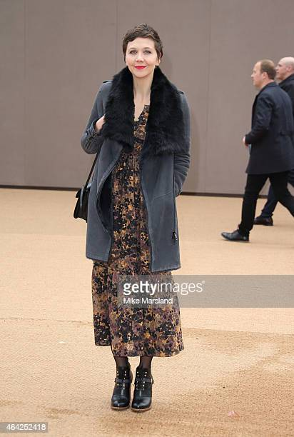 Maggie Gyllenhaal attends the Burberry Prosum show during London Fashion Week Fall/Winter 2015/16 at perk's Field on February 23 2015 in London...