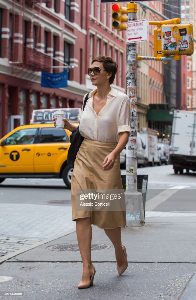 <a gi-track='captionPersonalityLinkClicked' href=/galleries/search?phrase=Maggie+Gyllenhaal&family=editorial&specificpeople=202607 ng-click='$event.stopPropagation()'>Maggie Gyllenhaal</a> is seen walking in SoHo after lunch at Le Pain Quotidien on July 29, 2014 in New York City.